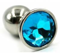 Серебристая гладкая анальная пробка с голубым кристаллом - 7 см.